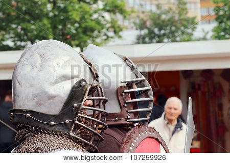 Profile Of Two Men Dressed In Medieval Chain Mail And Metal Helmet