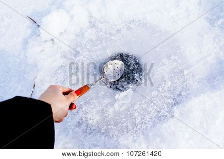 Clean Ice Hole In Frozen Lake