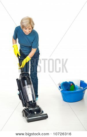 Housewife Working With Vacuum Cleaner