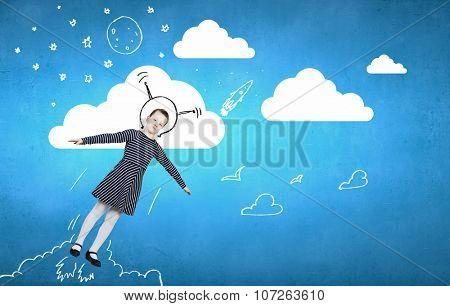 Cute girl astronaut dreaming like she is flying in open space