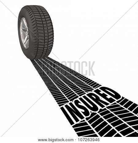 Insured word in tire tracks behind a wheel to illustrate insurance coverage, policy and protection