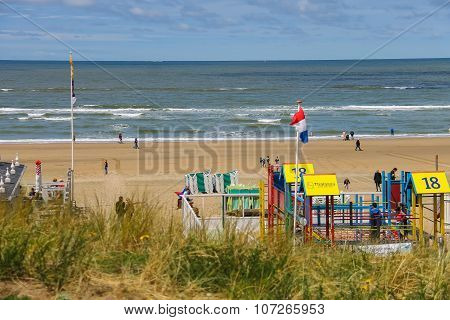 Tourists Walking Along The Sea Line In Zandvoort, The Netherlands