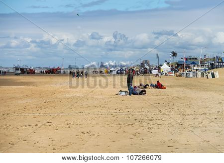 People On Sandy Beach Near North Sea In Zandvoort, The Netherlands