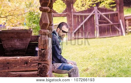 Bearded Man Sitting On The Porch