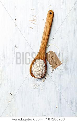 Organic amaranth on a wooden spoon (puffed)