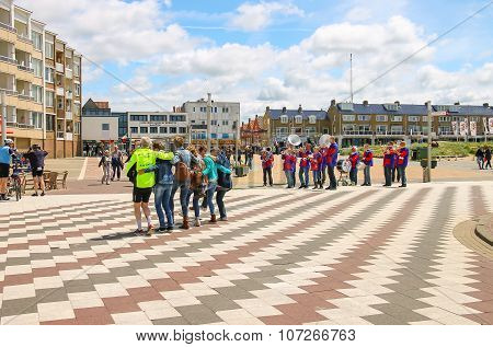 Tourists Dancing On The Square In Zandvoort, The Netherlands