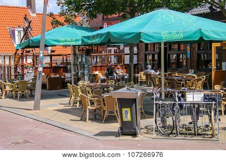 People Sitting In A Street Cafe In Zandvoort, The Netherlands.