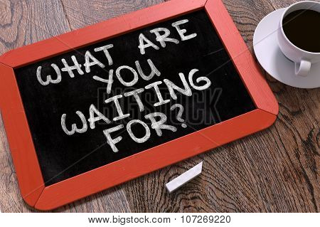 What are You Waiting For - Inspirational Quote on a Blackboard.