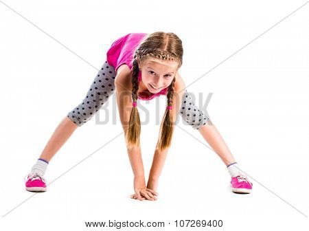 cute little girl stretching isolated on white background