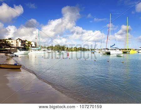 Catamarans and boats in a bay. Grand Bay (Grand Baie). Mauritius