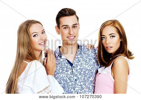Group of happy young people having fun together. Friends. Isolated over white.
