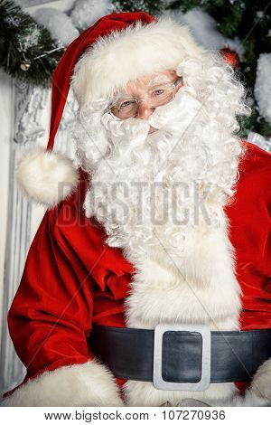 Close-up portrait of a good old Santa Claus over Christmas background.