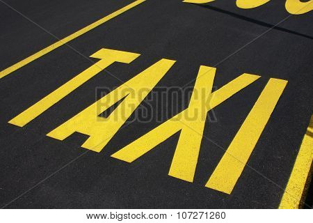 Taxi Stop Sign On The Road