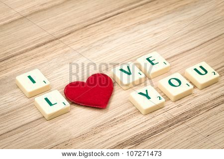 Valentine's Hearts On A Wooden Background