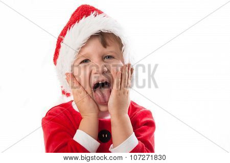 Smiling Funny Child In Santa Red Hat  In Hand. Christmas Concept.