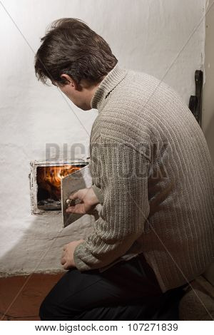 Man Heating Old Stove