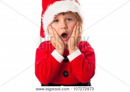 Surprised Child In Santa Red Hat And Costume  Christmas Concept.