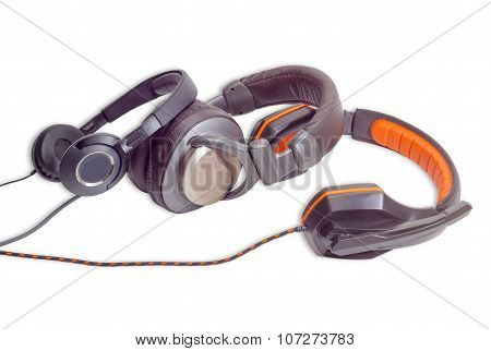 Three Different Pairs Of Headphones On A Light Background