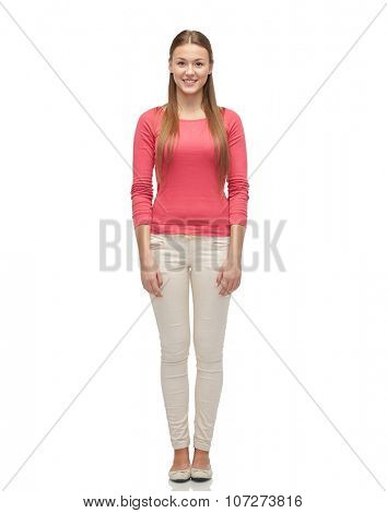 female, gender, fashion and people concept - smiling young woman or teenage girl in pink pullover and jeans
