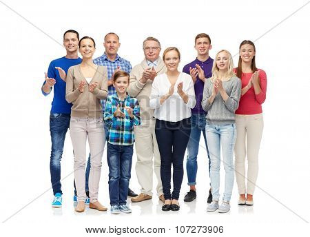 family, gender, generation and people concept - group of smiling men, women and boy applauding