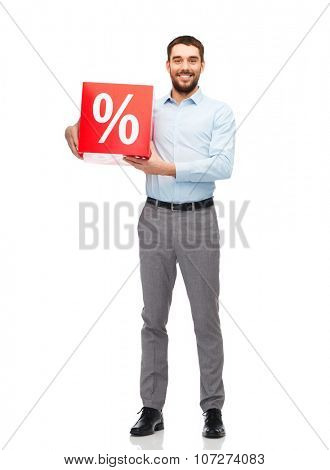 people, sale, shopping, discount and holidays concept - smiling man holding red percentage sign
