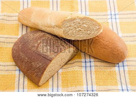 Different Types Of Bread On A Checkered Tablecloth