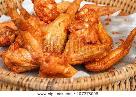 Fried chicken wings on oil blotting paper