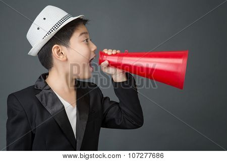 Little Asian Boy Using Megaphone Shouting