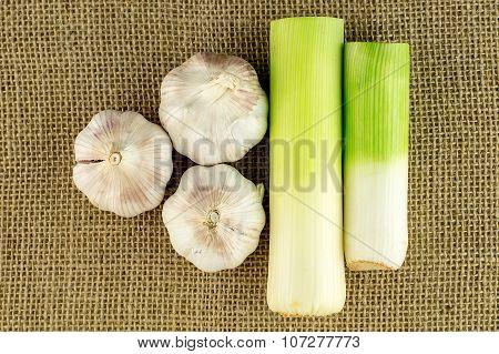Aerial Of Garlic And Leek On Rustic Farm Background