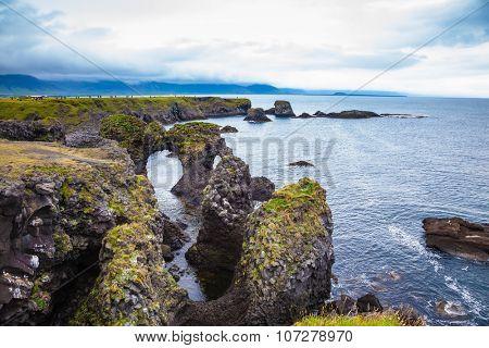 Magical coastal cliffs fishing village Arnastapi. July day in Iceland