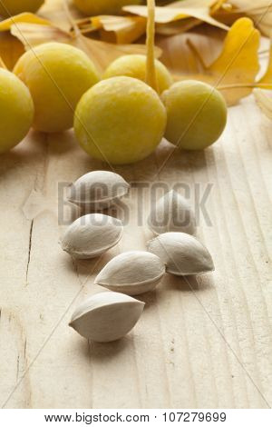 Ripe yellow Ginkgo biloba fruit and nuts