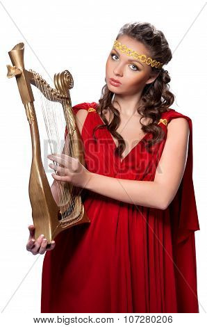Beautiful Young Girl Playing The Harp