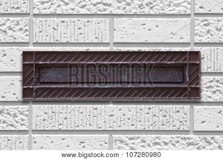 Old style letterbox and concrete wall background