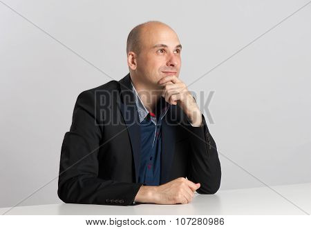 Businessman Sitting At The Desk And Thinking