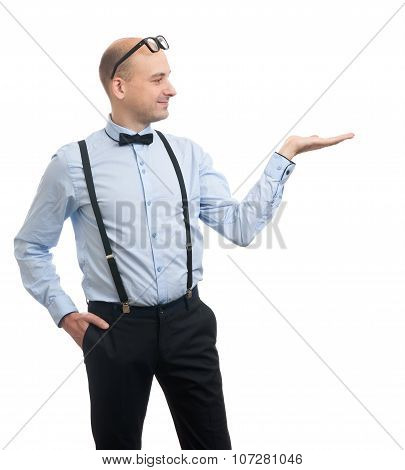 Man Wearing Bow Tie And Suspenders Presenting Something
