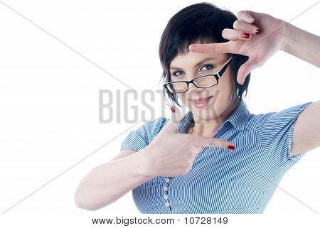 Girl showing frame sign