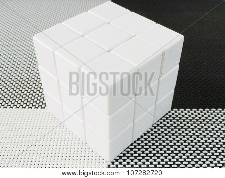 white cube on a black and white mat