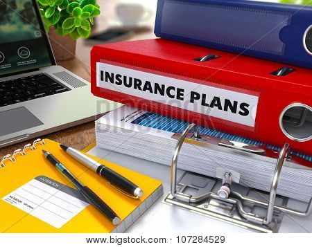 Red Ring Binder with Inscription Insurance Plans.