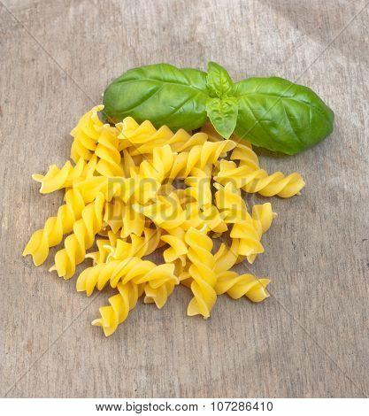 Fine fusilli noodles on wooden board