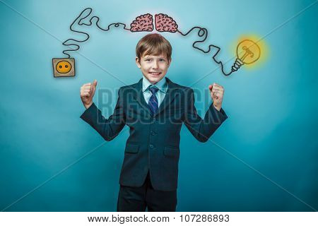 Teen boy businessman showing strength at the hands of the chargi