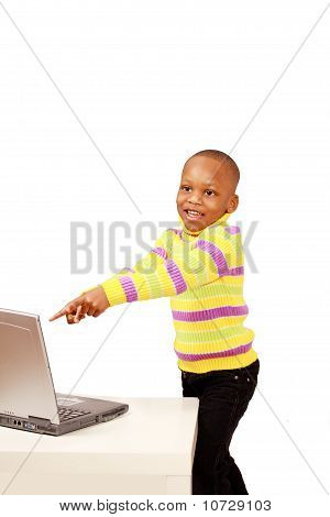 Excited Kid Points To Computer