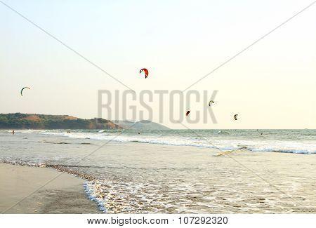 People ride on Kitesurf at sea