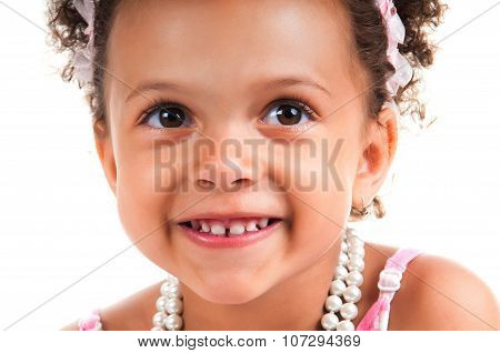 Close-up Portrait Of Young Girl With Curly Hair. Smiling Face. Happy Childhood