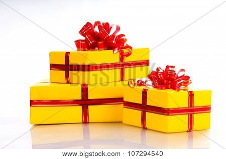 Yellow Gift Box With A Red Bow Isolated On White Background