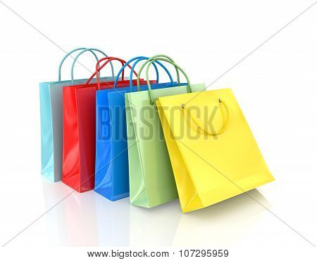 Three Colorful Paper Bags For Shopping On A White Background.