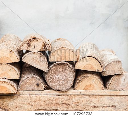 Stack Of Firewood Decorated In Garden
