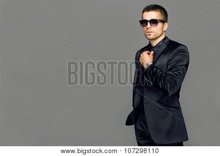 Young handsome man in a suit