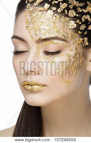 Girl with gilden foil makeup