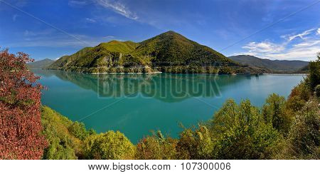 Green Lake Surrounded With Autumn Trees