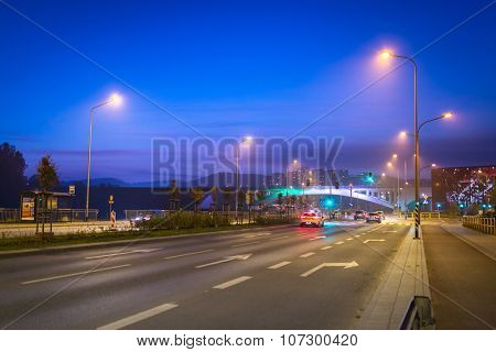 GDANSK, POLAND - OCTOBER 31, 2015: Cars on the highway in the city center of Gdansk at night, Poland. Gdansk is the biggest city of Polish Pomerania at Baltic Sea.
